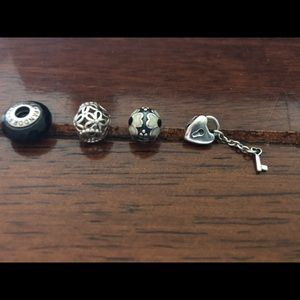 Authentic retired Bundle of 4 PANDORA charms